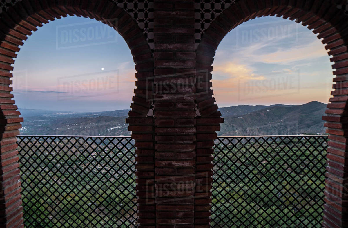 Horseshoe arched window at Comares village. Pueblo blanco up on  Royalty-free stock photo