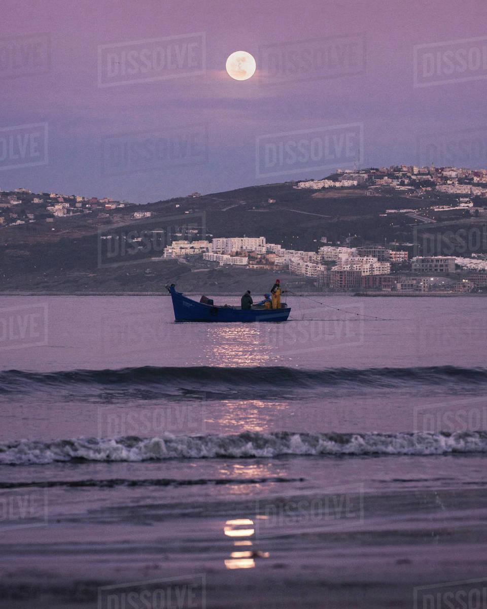 Fishing under moonlight Royalty-free stock photo