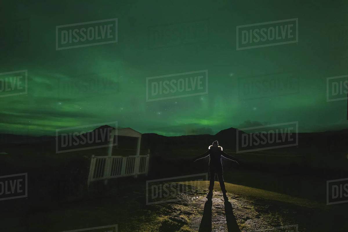 Human silhoutte under Northern lights. Royalty-free stock photo