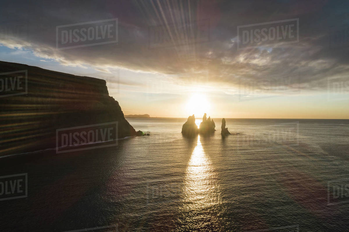 Sunbeams between the rocks of Reynisfjara Beach Royalty-free stock photo