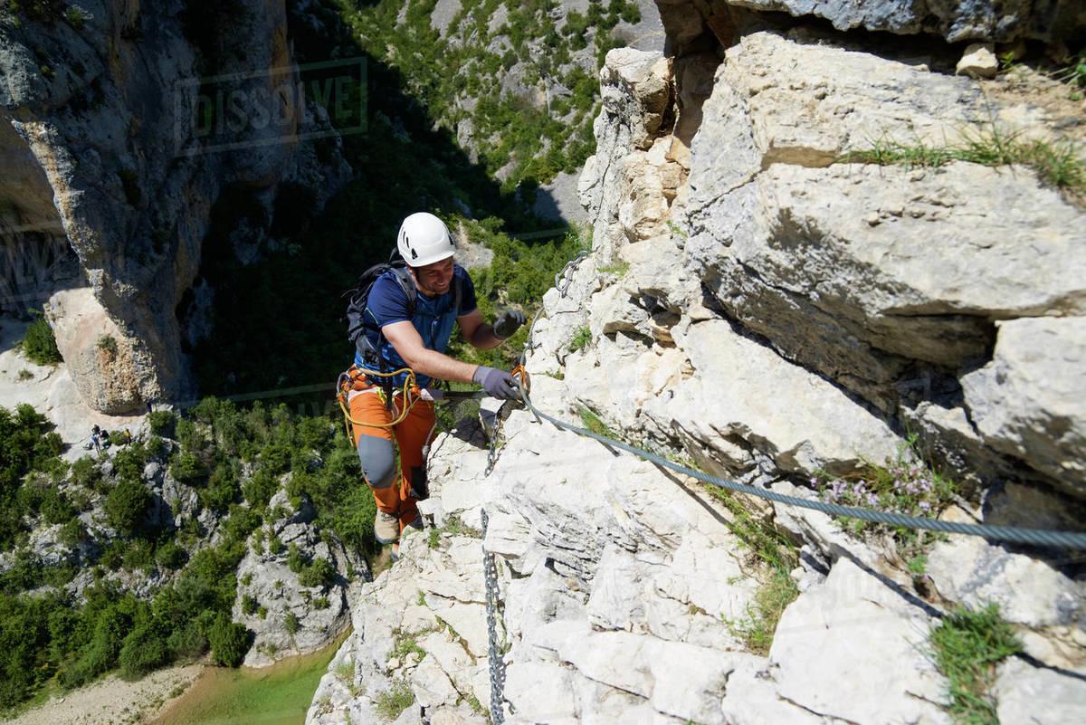 Climbing a ferrata route in Mascun Ravine in Guara Mountains. Royalty-free stock photo