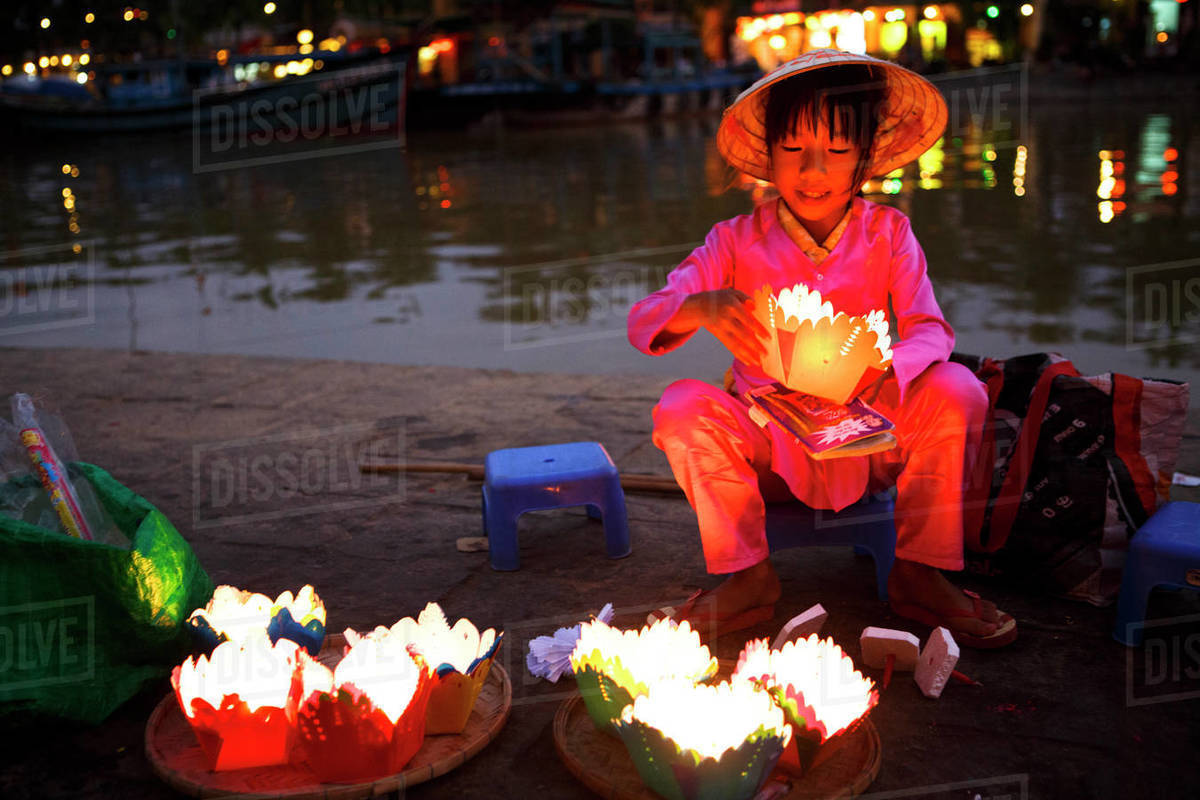 A Child Sells Lanterns Along the Thu Bon River in Hoi An, Vietnam Royalty-free stock photo