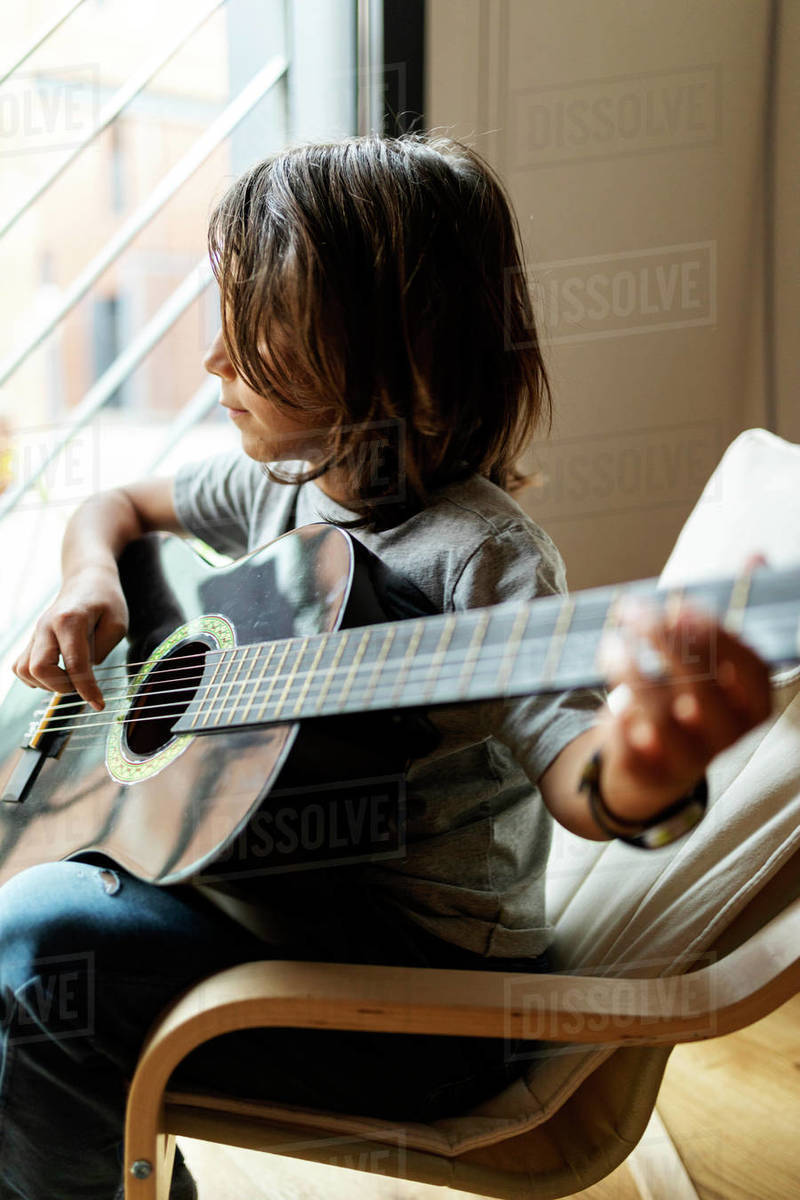 Teenage boy playing guitar Royalty-free stock photo