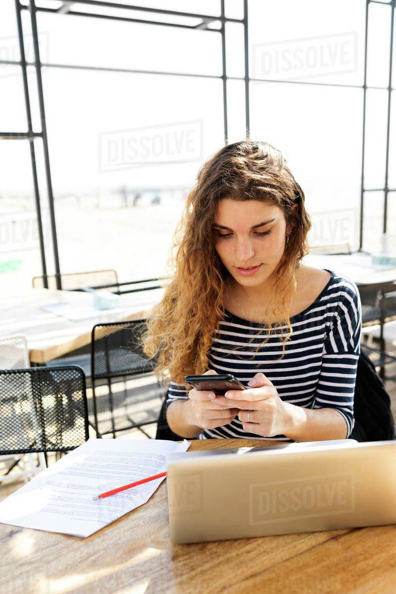 Young beautiful happy woman working with laptop and texting Royalty-free stock photo