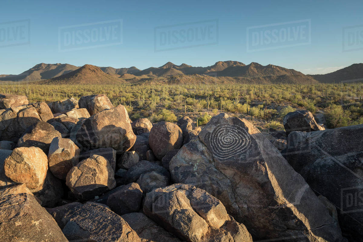 Desert landscape with a spiral petroglyph Royalty-free stock photo