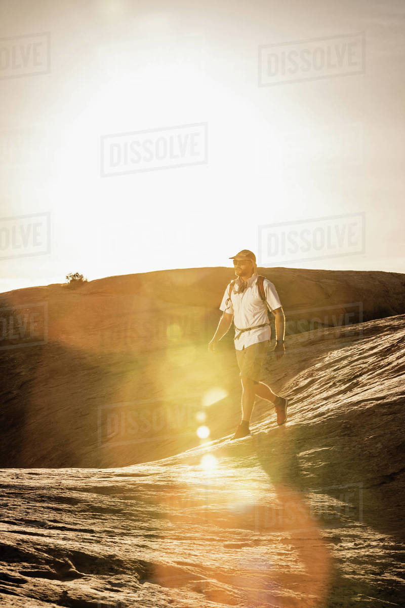 A man hiking in the sun and heat of the desert. Royalty-free stock photo
