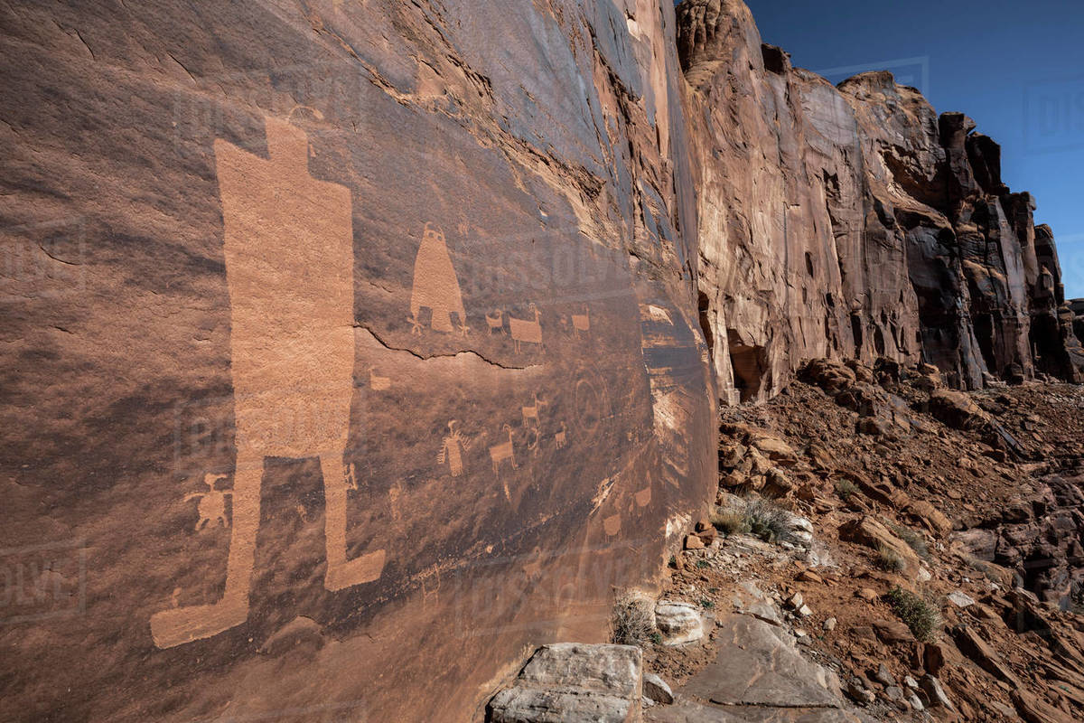 Native American petroglyphs etched into sandstone rock. Royalty-free stock photo