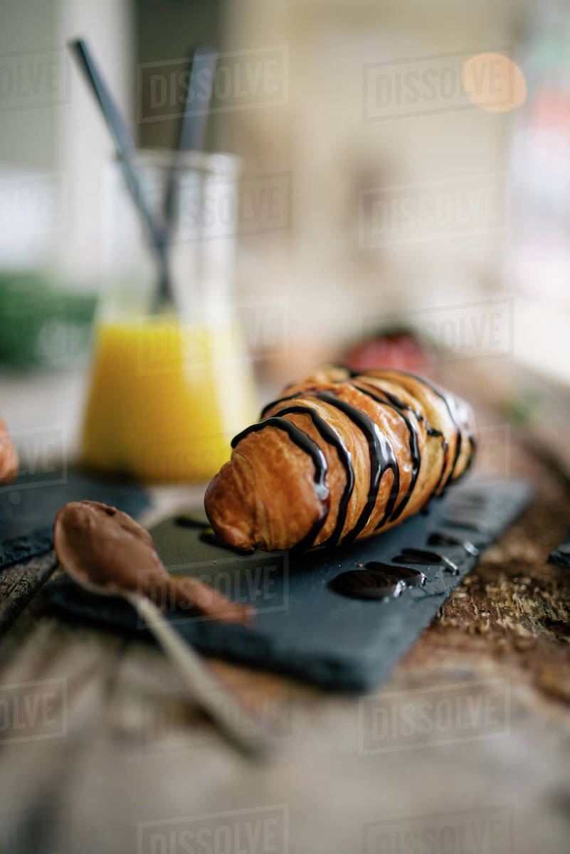 Croissant for breakfast on rustic wooden table in a restaurant. Royalty-free stock photo