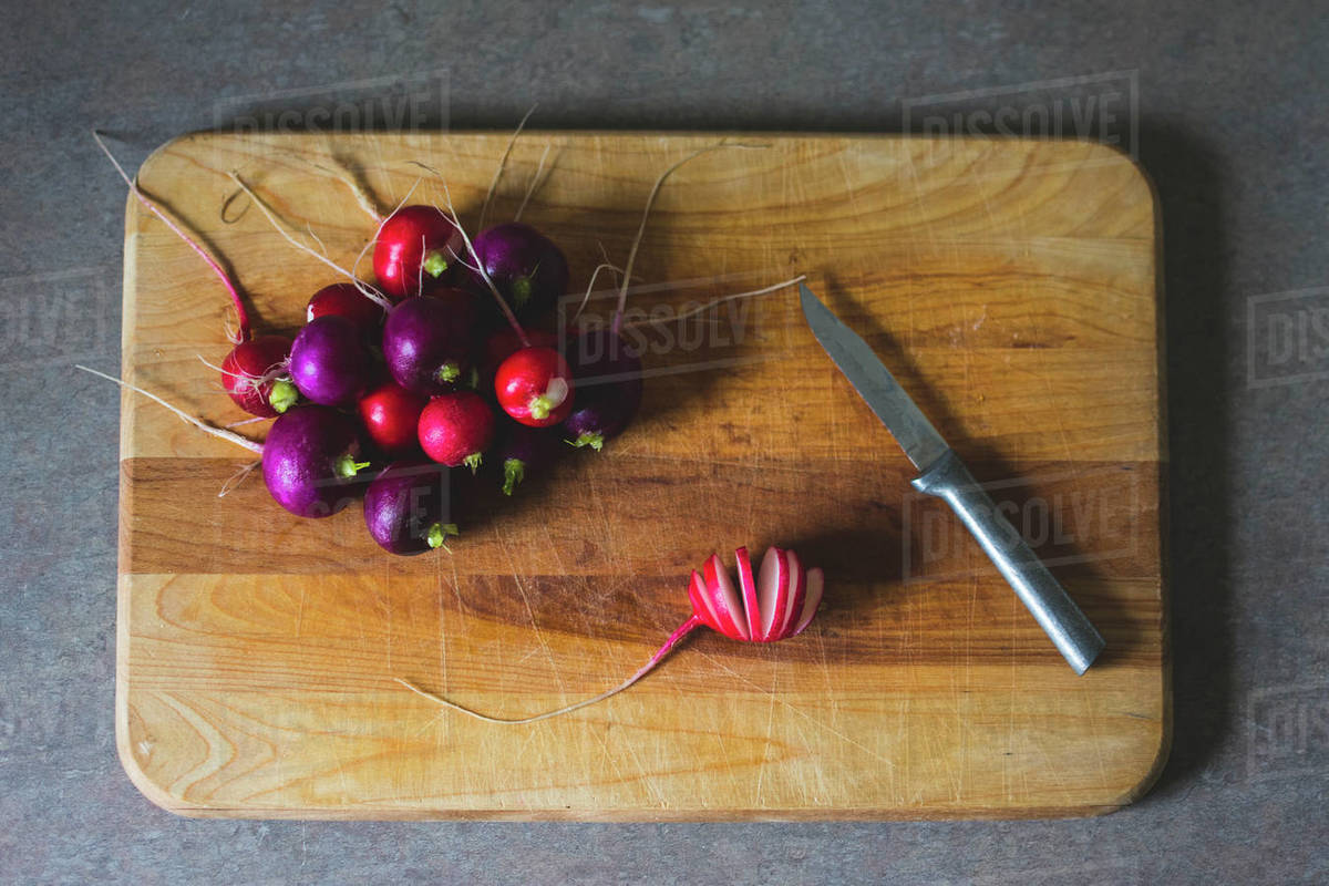Fresh Radishes on a Wooden Cutting Board in a Kitchen Royalty-free stock photo