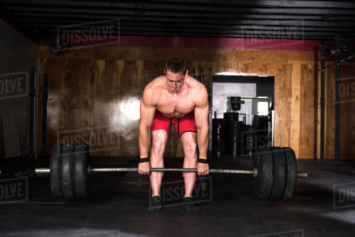 An athlete deadlifting at a gym in San Diego, CA. Royalty-free stock photo