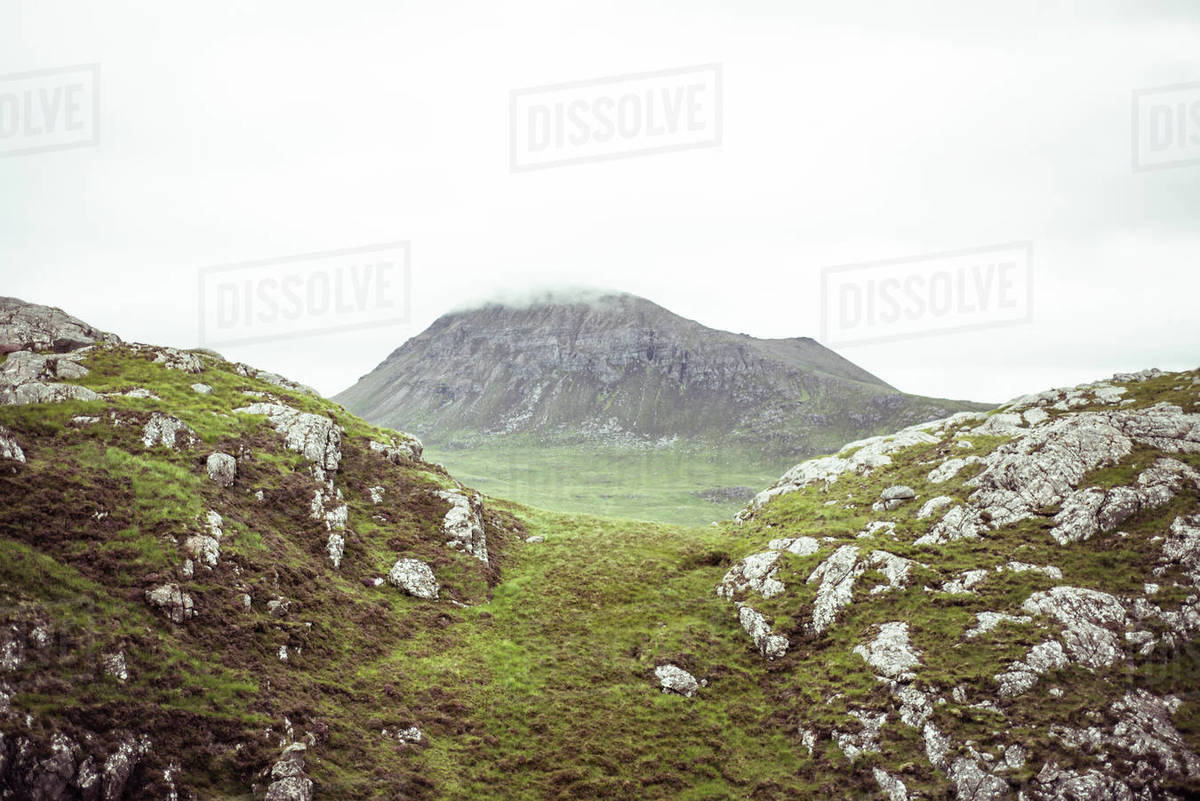 Cloud covered rocky mountain top in mist Royalty-free stock photo