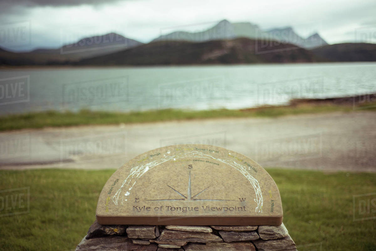 Stone compass in front of mountain lakes Royalty-free stock photo