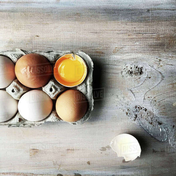 Overhead view of eggs in tray on table Royalty-free stock photo