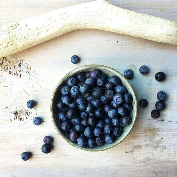 Overhead view of blueberries in bowl on table Royalty-free stock photo