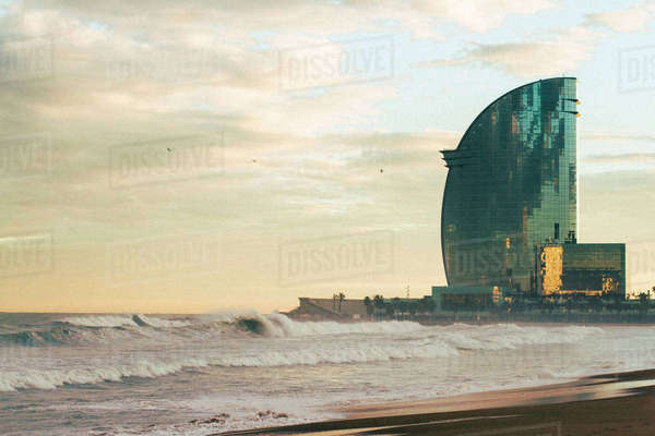 View of W Barcelona hotel by beach against sky Royalty-free stock photo