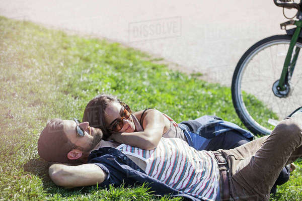 Romantic couple lying on grass at park Royalty-free stock photo