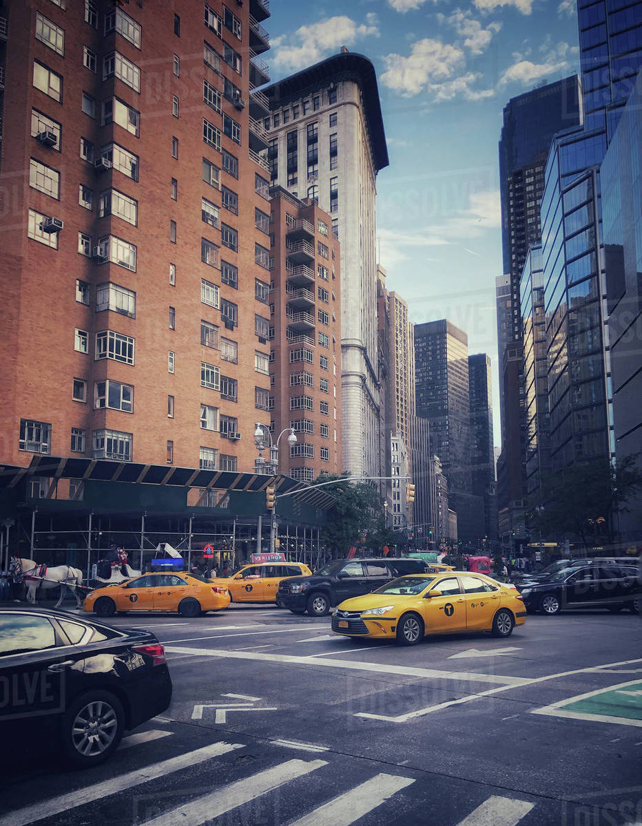 Street scene with buildings, cars and taxis in New York City, USA. Royalty-free stock photo