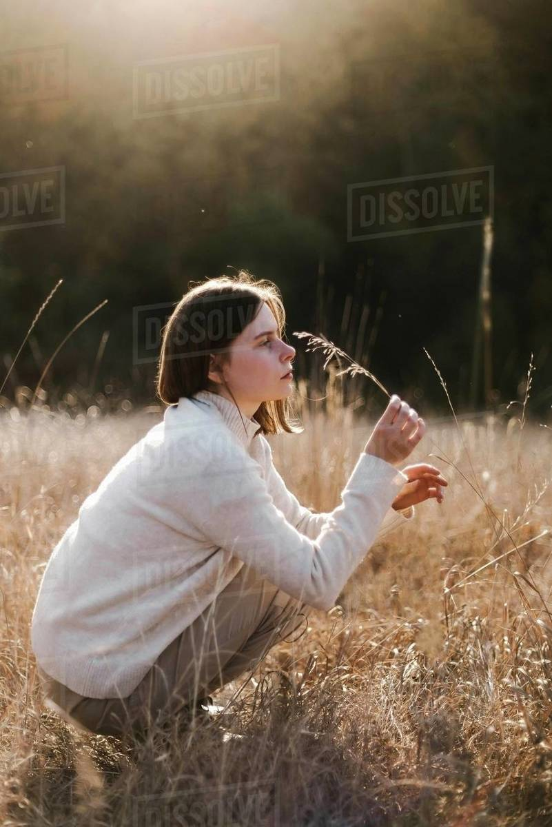 Beautiful portrait of a young stylish woman on a sunny day in autumn Royalty-free stock photo