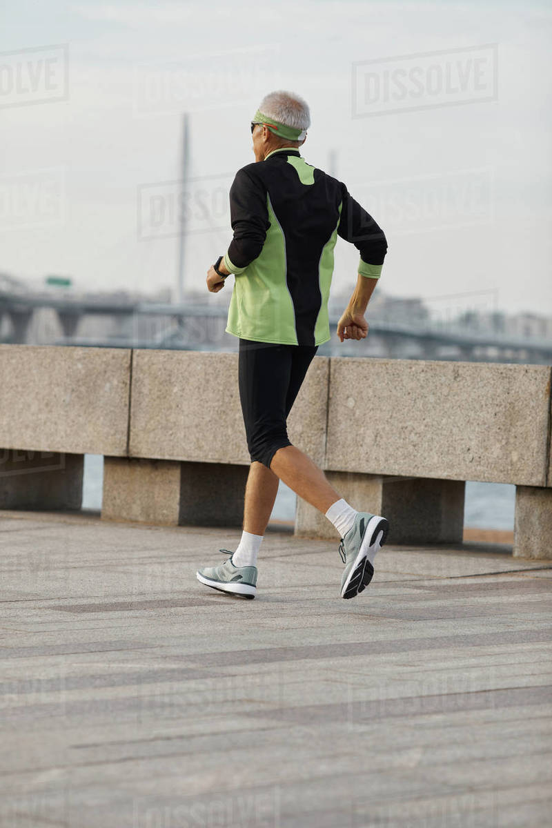 Unrecognizable Aged Man Jogging Along Seaside Royalty-free stock photo