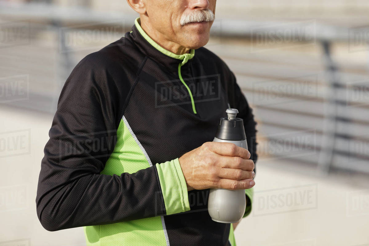 Sporty Senior Man With Bottle of Water Royalty-free stock photo