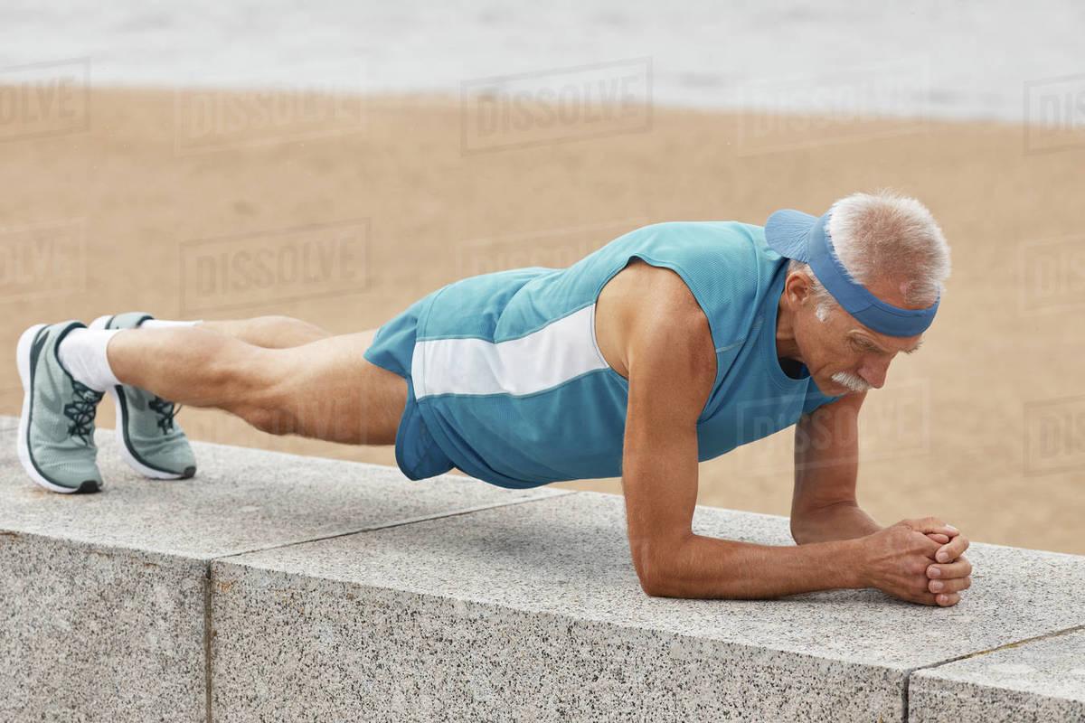 Man Practising Dolphin Plank Pose Royalty-free stock photo