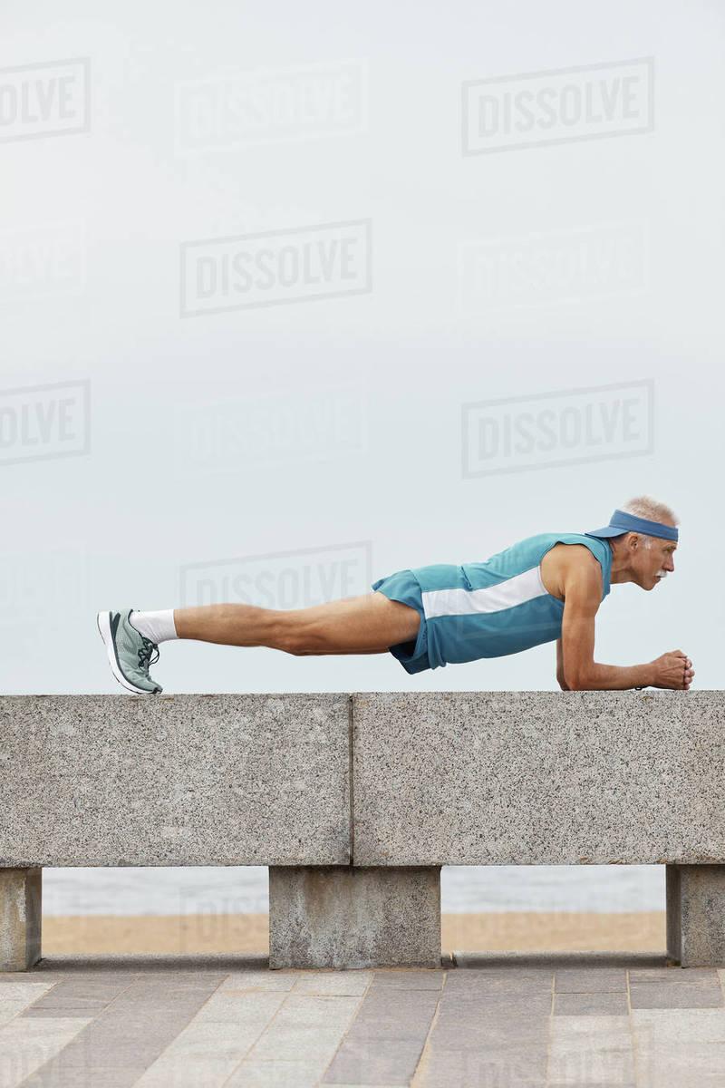 Strong Senior Man Doing Plank Exercise Royalty-free stock photo