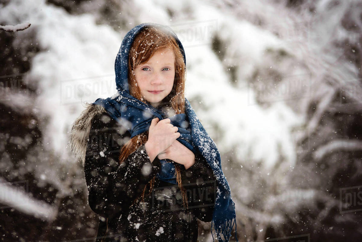 Young Red Haired Girl Playing outside in the Snow Royalty-free stock photo