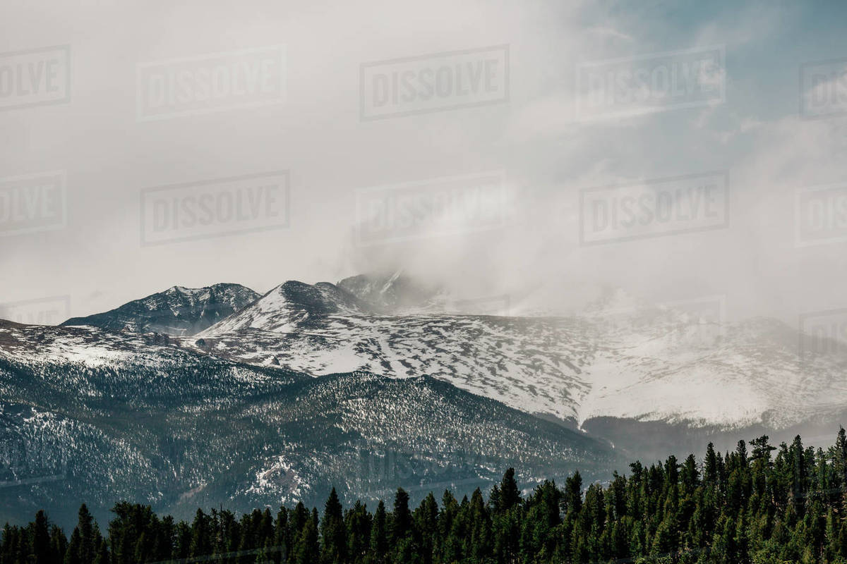 Clouds move over a mountain in Rocky Mountain National Park, Colorado. Royalty-free stock photo
