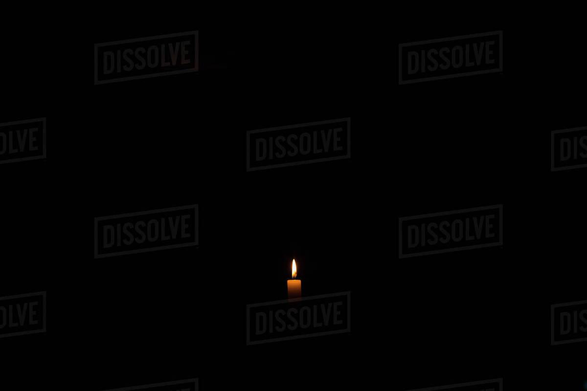 Burning Candle In Dark Room Stock Photo Dissolve