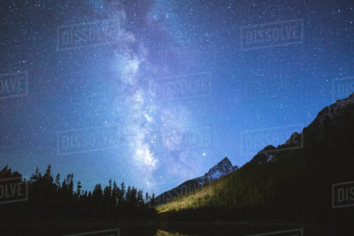 The Milky Way glows brightly above the Grand Teton Mountain Range. Royalty-free stock photo