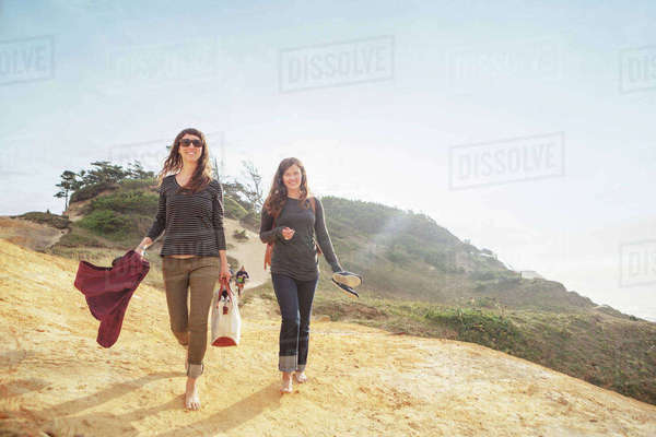 Happy women walking on mountain against sky Royalty-free stock photo