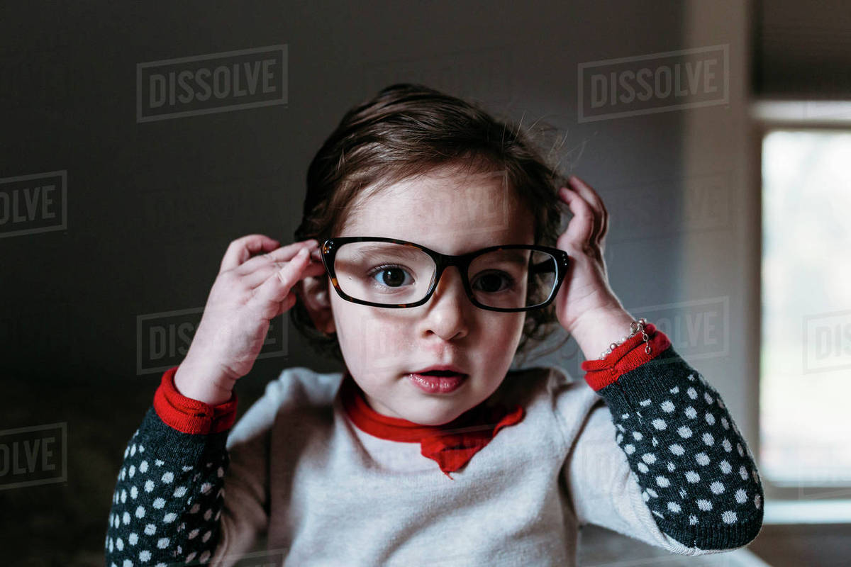 e67845a3bf Portrait of cute girl wearing eyeglasses at home - Stock Photo ...