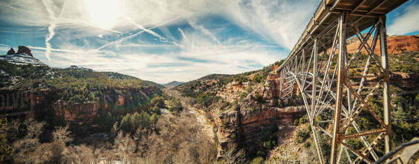 Panoramic view of bridge amidst rocky mountains Royalty-free stock photo
