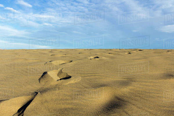 Scenic view of arid landscape against sky Royalty-free stock photo