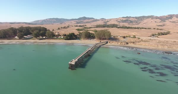 Rising aerial shot of pier in the afternoon with camera tilt. Royalty-free stock video