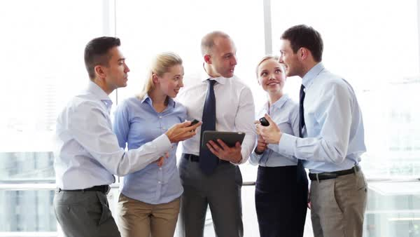Business Team With Tablet And Smartphones Meeting In Office Royalty Free Stock Video
