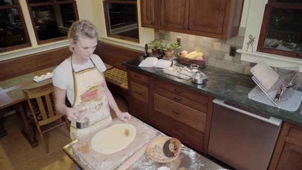 Medium shot of a woman sprinkling dough with brown sugar Royalty-free stock video