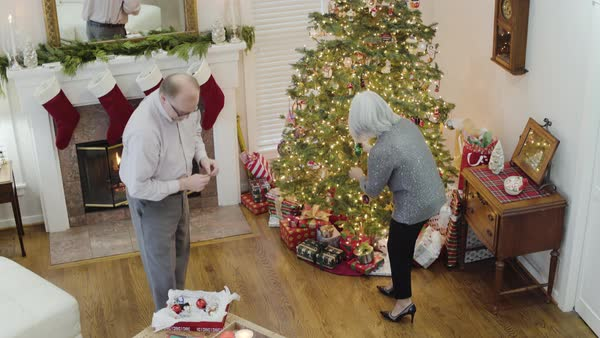 High-angle shot of a senior couple decorating a Christmas tree Royalty-free stock video
