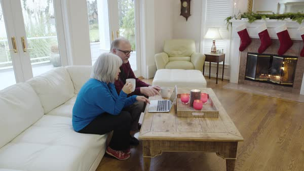 Medium wide shot of a senior couple using a laptop Royalty-free stock video