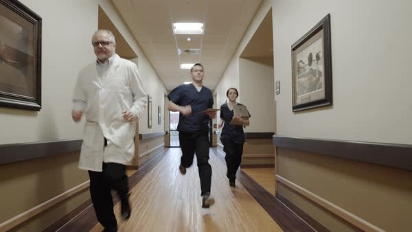 Dolly shot of medical staff running down a corridor Royalty-free stock video