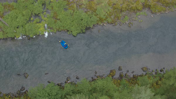 Extreme wide shot of four people rafting on a river Royalty-free stock video