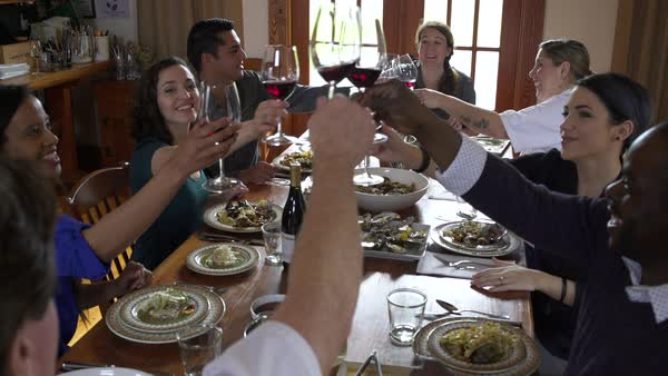Chefs and students toasting at a dining table Royalty-free stock video