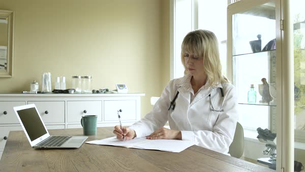 A doctor taking notes in an office Royalty-free stock video