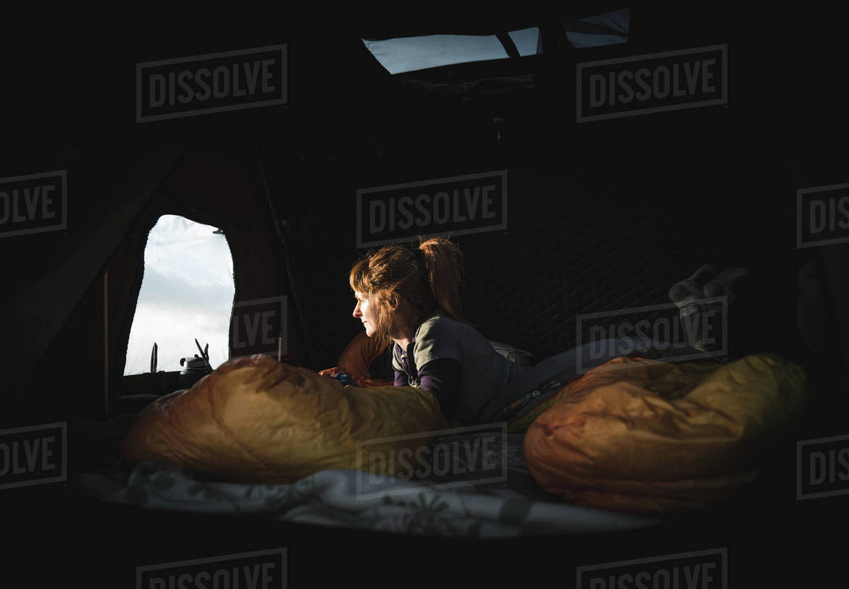 Side view of a woman lying in tent Royalty-free stock photo