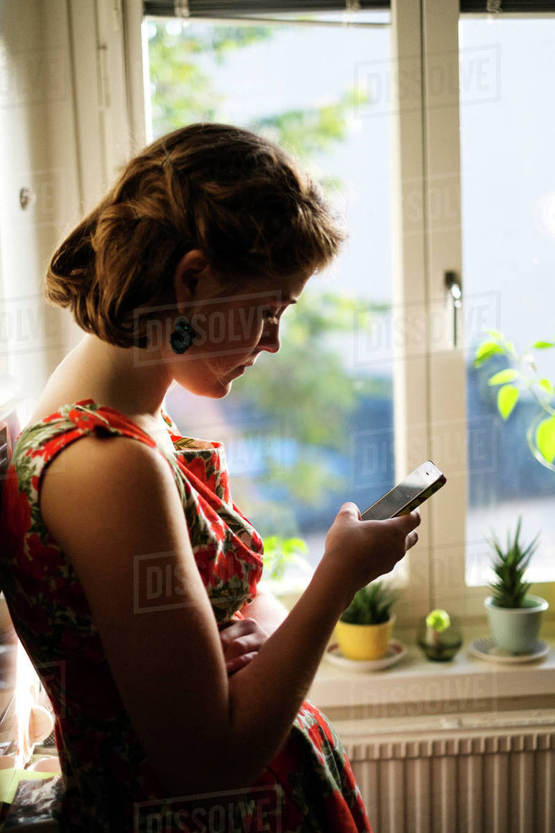 Sweden, Young woman texting on smart phone Royalty-free stock photo