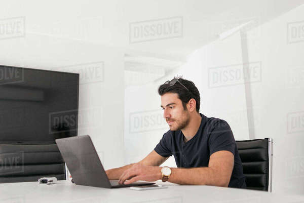 Israel, Man using laptop at home Royalty-free stock photo