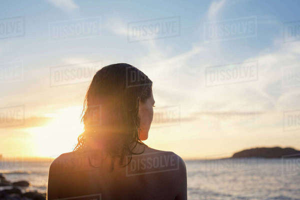 Australia, New South Wales, Botany Bay, Rear view of woman looking at sea during sunset Royalty-free stock photo