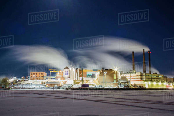 Sweden, Medelpad, Sundsvall, Smoke over paper mill at night Royalty-free stock photo