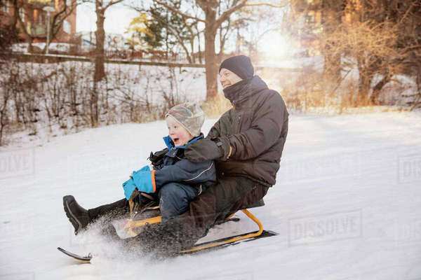 Sweden, Sodermanland, Johanneshov, Father with son (4-5) tobogganing Royalty-free stock photo