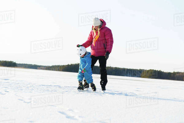 Sweden, Sodermanland, Jarna, Mother teaching son (2-3) ice skating on frozen lake Royalty-free stock photo